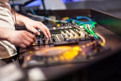 DJ mixing music on console Royalty Free Stock Images