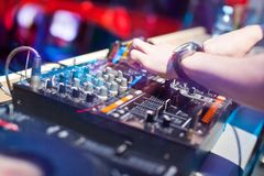 DJ mixing music on console Stock Photography