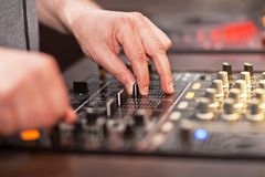 DJ mixing music on console Royalty Free Stock Photos