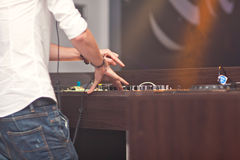DJ mixing music on console Stock Image