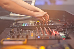 DJ mixing music on console Royalty Free Stock Photo