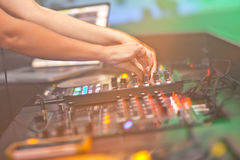 DJ mixing music on console Stock Photos