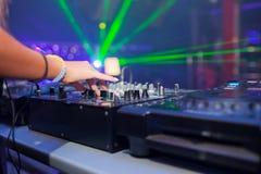DJ mixing music on console Stock Photo