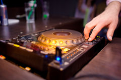 DJ mixing music on console Stock Images