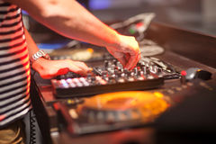 DJ mixing music on console at the night club Royalty Free Stock Image