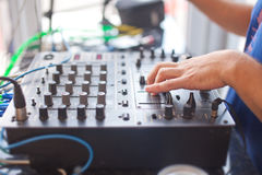 DJ mixing music on console at the night club Royalty Free Stock Photography