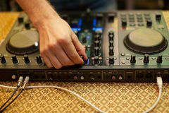 DJ mixing music on console at the night club Royalty Free Stock Photos