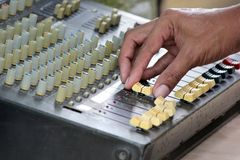 DJ mixing music on console of sound music mixer Stock Photo