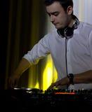 DJ mixing music at a disco stock photo