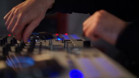DJ mixing music on his deck stock footage