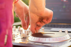 Dj mixing music outdoor. Royalty Free Stock Images