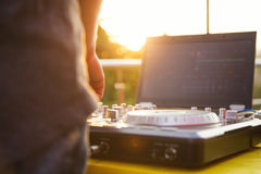 Dj mixing music outdoor. Royalty Free Stock Photography