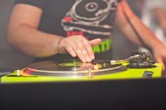 DJ mixing music on vinyl record at the night club Stock Photo