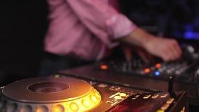 Dj mixing at the night club stock footage