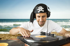 DJ mixing  pirate on the beach Royalty Free Stock Image