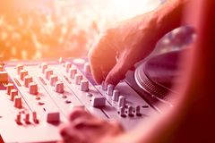 Dj mixing and playing music in nightclub. At the party Royalty Free Stock Photo