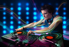 Dj mixing records with colorful lights Royalty Free Stock Photos
