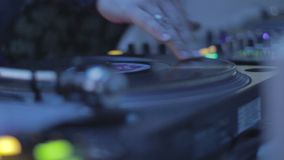 DJ mixing records, playing music, hands scratching vinyl platter. Stock footage stock footage