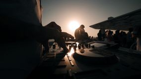 DJ mixing and spinning at summer party on the boat. DJ at work on summer sea in Dubai stock video