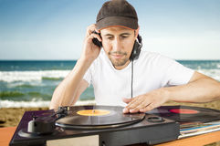 DJ mixing vinyl record on a  turntable Royalty Free Stock Photo