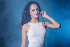 Dj, music. Beautiful girl with headphones Stock Image