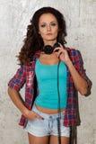 Dj, music. Beautiful girl with headphones Royalty Free Stock Photography