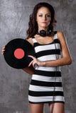 Dj, music. Beautiful girl with headphones Royalty Free Stock Photo