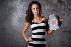 Dj, music. Beautiful girl with vinyl Stock Photos