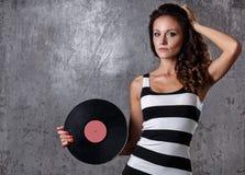 Dj, music. Beautiful girl with vinyl Royalty Free Stock Photo