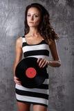 Dj, music. Beautiful girl with vinyl Stock Images