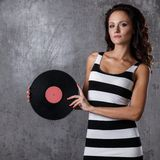 Dj, music. Beautiful girl with vinyl Royalty Free Stock Images