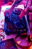 DJ at Music Mixer. Close up of unrecognizable DJ playing music at mixer console during club party Stock Photo