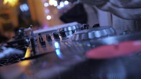 Dj Music Night Club. DJ playing music on record player, also knows as turntable in night club with light bokeh stock video
