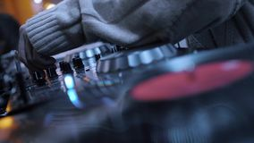 Dj Music Night Club. DJ playing music on record player, also knows as turntable in night club with light bokeh stock footage