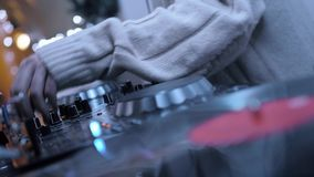 Dj Music Night Club. DJ playing music on record player, also knows as turntable in night club with light bokeh stock video footage