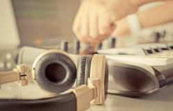 DJ music producer is turning knob on his studio royalty free stock images