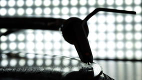 Dj needle stylus on record, blur light background Stock Photo