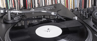 Dj needle stylus on spinning record Royalty Free Stock Photos
