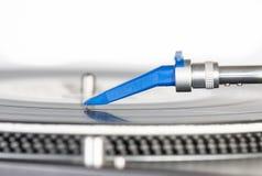 DJ needle on a vinyl record. Closeup of a DJ needle on black vinyl record on a classic turntable Stock Images