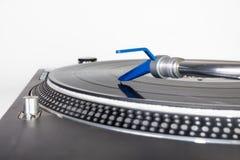 DJ needle on a vinyl record. Closeup of a DJ needle on black vinyl record on a classic turntable Royalty Free Stock Photo