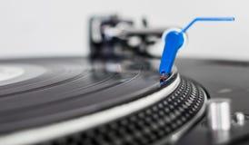 DJ needle on a vinyl record. Closeup of a DJ needle on black vinyl record on a classic turntable Royalty Free Stock Photos