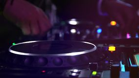 Dj in the party. Dj play music in the wedding party with lights and disc