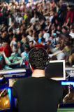 DJ performing in the club. With crowd in the background Royalty Free Stock Images