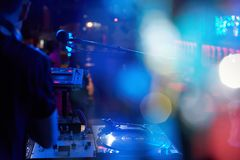 DJ performs in a nightclub at a party. stock photos