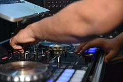 Dj play with mixing table stock photography