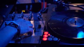 Dj play music at hip hop party. Turntable vinyl record player,analog sound technology for disc jockey to scratch vinyl records and mix tracks. Music festival Stock Photography