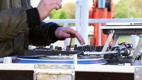 DJ Play Music, Scratching Vinyl Record On Turntable On Open Air Party. Hands Close-up. DJ Play Music, Scratching Vinyl Record On a Turntable On Open Air Party stock footage