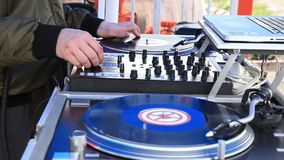 DJ Play Music, Scratching Vinyl Record On Turntable On Open Air Party. Hands Close-up.