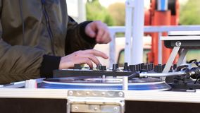 DJ Play Music, Scratching Vinyl Record On Turntable On Open Air Party. Hands Close-up. DJ Play Music, Scratching Vinyl Record On a Turntable On Open Air Party stock video