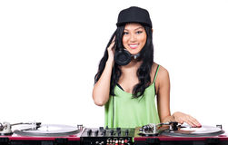 DJ play that record. A young Asian girl dressed in black and green DJing Royalty Free Stock Image